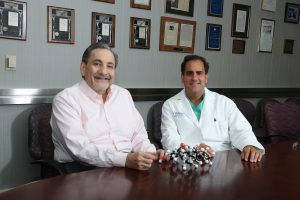 Dr Bazan with Hernan Bazan, MD (Vascular Surgeon at Ochsner Hospital, Clinician-Scientist, Co-Founder of South Rampart Pharma) showing model of novel generation of non-toxic, non-addictive pain killers just identified